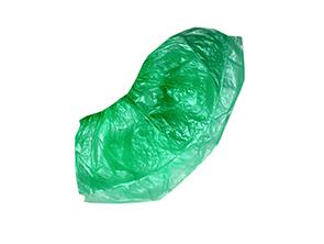 На изображении зеленые бахилы